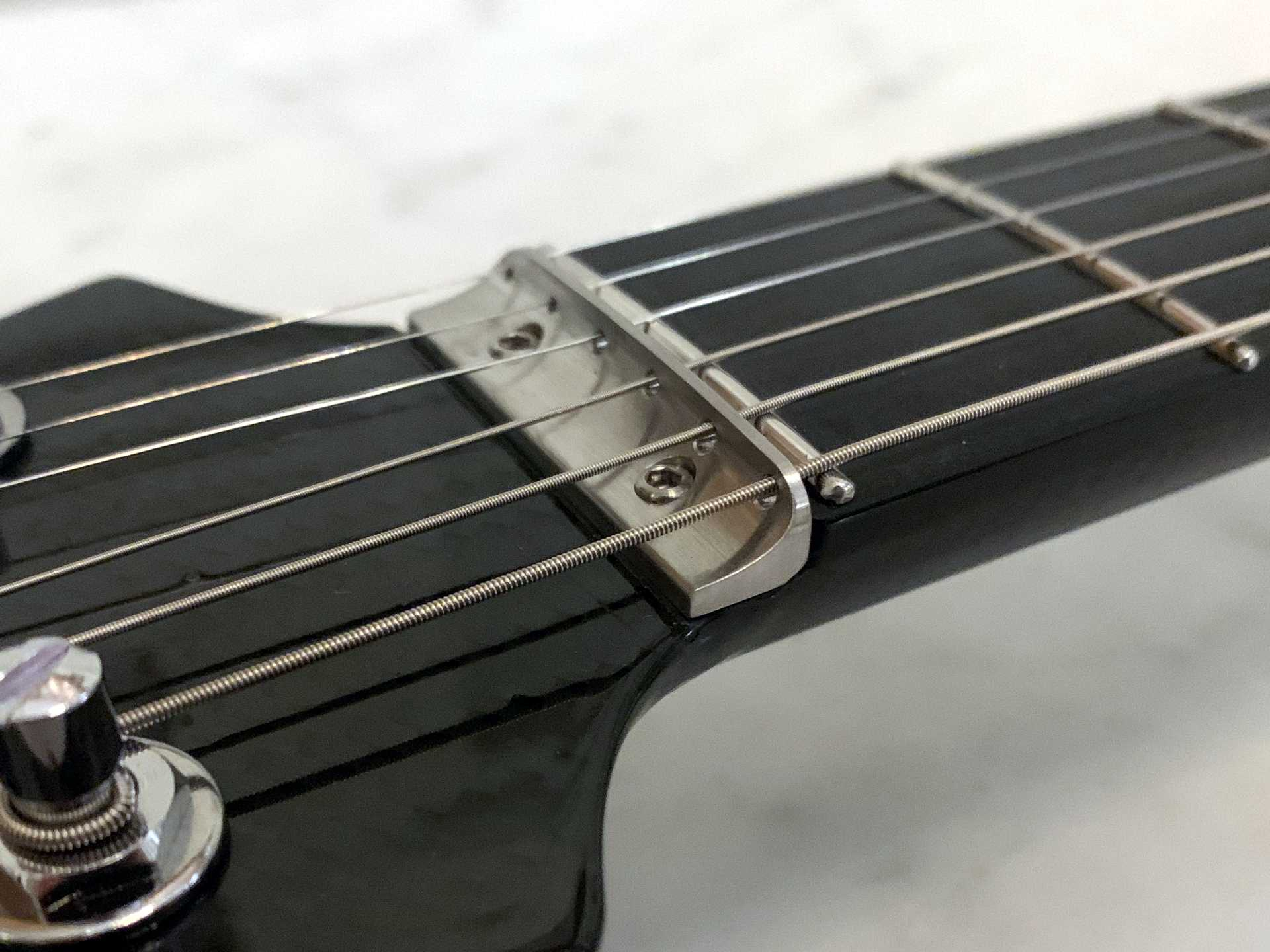 Stainless steel string guide
